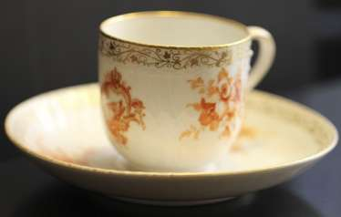 Cup and saucer from the service with a crest and monogram, KPM, mid XIX century