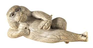 Okimono of a reclining monkey ivory