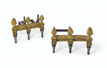 A PAIR OF LOUIS XVI ORMOLU AND STEEL CHENETS