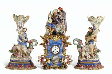 AN ASSEMBLED FRENCH PORCELAIN THREE-PIECE CLOCK GARNITURE