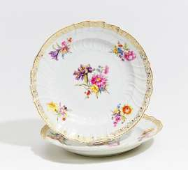 Two deep plates with floral decoration and the monogram of Wilhelm II