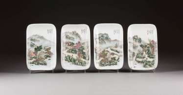 FOUR FLAT PLATE WITH A MOUNTAIN LANDSCAPE
