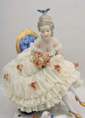 VOLKSTEDT PORCELAIN, Sitting with a bouquet of flowers.
