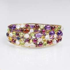 Gold bangle bracelet with rich color stone trim