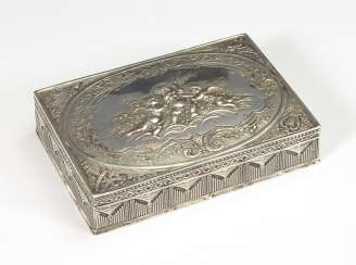 Silver box with putti in relief.