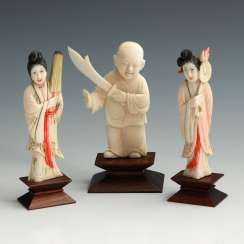 3 small ivory figures.