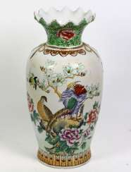 Floor vase with peacock decor