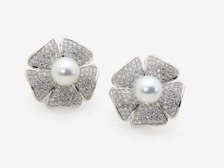 A Pair of stud earrings with cultured pearls and diamonds