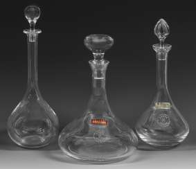 Three crystal carafes