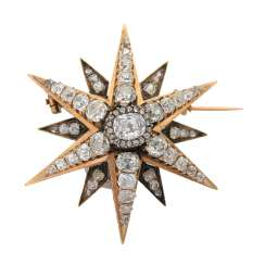 "Brooch ""star"" with numerous diamonds,"