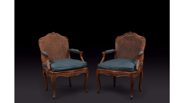 Pair of armchairs cannés shape eventful with decoration of foliage and flowers. Stamped out of Nicolas Heurtaut, carpenter received a master in 1753