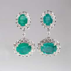 Couple of high-profile emerald and diamond earrings.