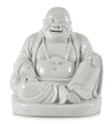 Dehua figure of a seated Budai