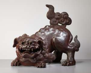 SCULPTURE OF A SNARLING SHISHI