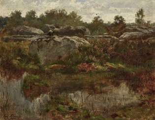 Painter in a rocky landscape
