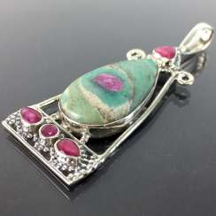 Worth seeing the trailer, an elongated slightly conical shape, with rubies and ruby in the mother rock, in silver 925.