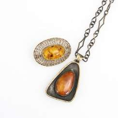 Amber pendant on chain and amber brooch