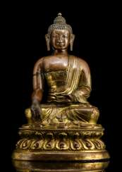 Partially fire-gilded and driven figure of Buddha Shakyamuni on a Lotus