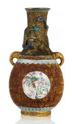 Unusual Vase made of porcelain with a neck in fire-gilt Bronze with Cloisonné-decor