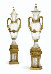 A MASSIVE PAIR OF ORMOLU AND CUT-GLASS VASES ON STANDS