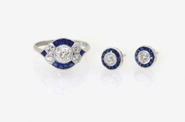 A Pair of stud earrings and a cocktail ring with sapphires and diamonds