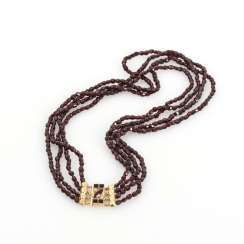 4-row garnet chain with decorative clasp