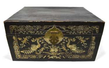 Leather chest with inlaid peacock decor