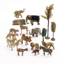 14 animals, 3 trees and 1 hedge