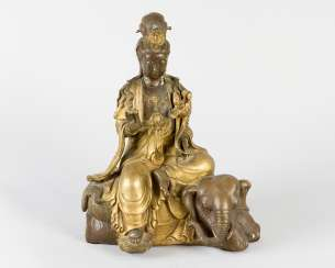 Guanyin sitting on elephant with lotus and bowl in her hands