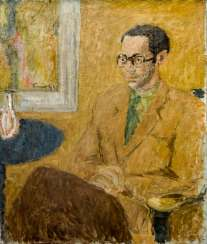 The seated man with glasses
