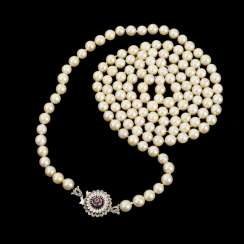 Long cultured pearl necklace with decorative clasp