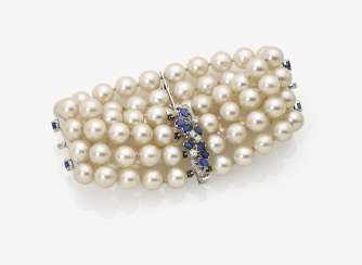 Four row Akoya cultured pearl bracelet with diamonds and sapphires