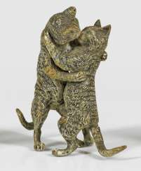 Group of figures with cats as a loving couple