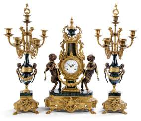 Large clock with two candelabra