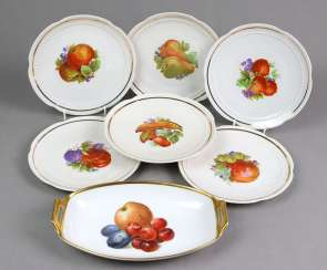 Set of fruit plates and serving bowl