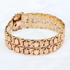 Wide gold bracelet with stars