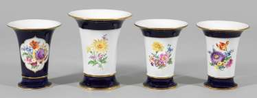 Four funnel vases with floral decoration