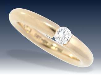Ring: quality-crafted, solid tension ring with a fine brilliant of approximately 0.25 ct, brand jewelry Niessing 18K yellow Gold