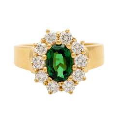 Ring with tsavorite, oval faceted surrounded by 10 brilliant
