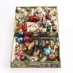 Mixed lot of old Christmas tree decorations in a tin box