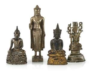 Four bronze figures of the Buddha