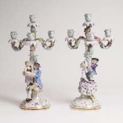Pair of large 4-armed figure chandelier 'mother and son' and 'father and daughter'