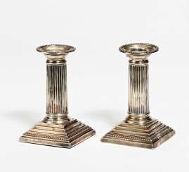 Pair of small pillared candlesticks