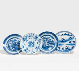 Four blue-and-white plates