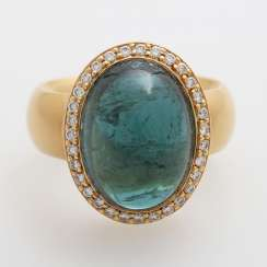 Ladies ring, m. occupied by a blue-green tourmaline,