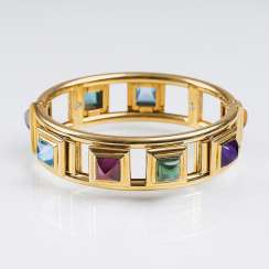 Gold bangle with colour stone trim