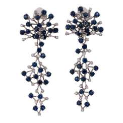 Ear clip hanger set with numerous sapphires and diamonds