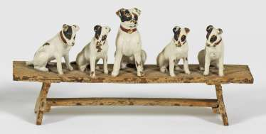 Miniature figure group with six Terriers on a bench