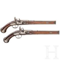 A pair of flintlock over and under pistols, German, around 1690/1700