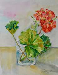 The branch of geranium in the glass.